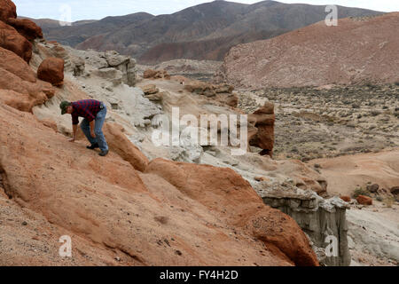 Hikers on cliffs Red Rock Canyon State Park California - Stock Image