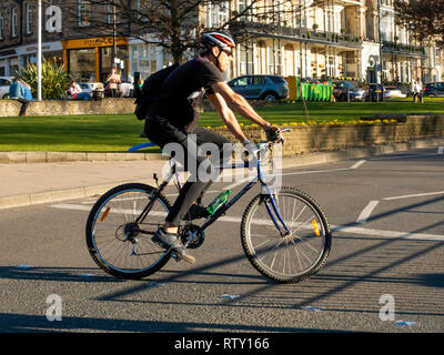 A young man riding a off road sports sports bicycle in Harrogate town centre North Yorkshire - Stock Image