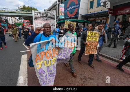 London, UK. 8th September 2018. A march through Brixton goes down the main street past the Underground station calling for the Windrush scheme to be widened to include all families and descendants of the Windrush Generation and for an end to the racist hostile environment for all immigrants. It demanded an amnesty for those living here without secure immigration status and for free movement for Commonwealth Citizens. Credit: Peter Marshall/Alamy Live News - Stock Image