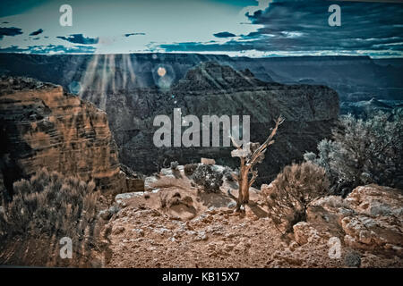 Evening sun rays over the Grand Canyon in Arizona creating spiritual scenery and mood for meditation. - Stock Image