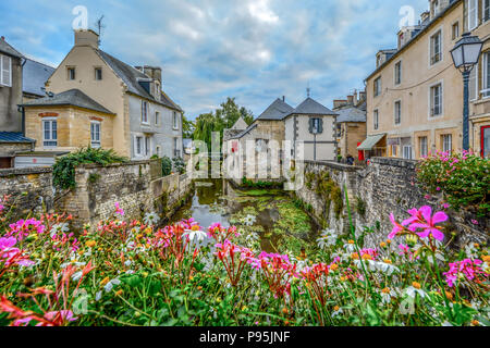 The picturesque French town of Bayeux France near the coast of Normandy with it's medieval houses overlooking the River Aure on an overcast day - Stock Image