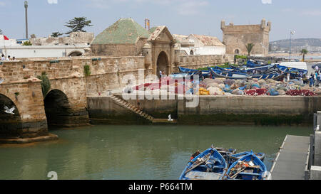 The busy and ancient port of Essaouira in Morocco with traditional boats. - Stock Image