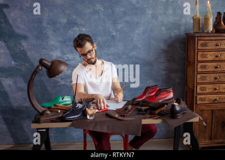 inspiration. creation of exclusive footwear, close up photo. copy space - Stock Image