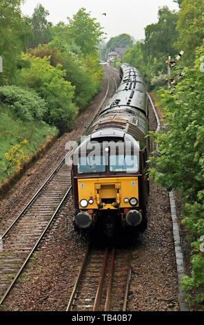 West Coast Rail locomotive 57314 leaves Parbold in West Lancashire with a special train, an excursion called the Stratford Flyer. - Stock Image