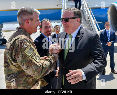 U.S. Secretary of State Michael R. Pompeo is greeted by General John Nicholson upon arrival to Bagram Airfield on July 9, 2018. - Stock Image