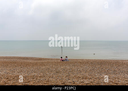 Couple of girls at the Beach, Hastings, East Sussex, England , UK - Stock Image