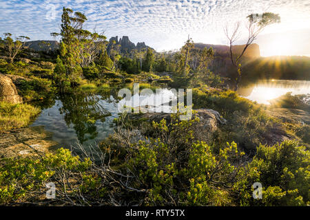 Sunrise over Lake Elysia, Mount Geryon and the Acropolis in Cradle Mountain–Lake St Clair National Park, Tasmania - Stock Image