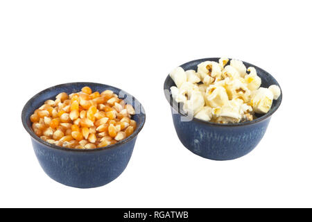 Bowls of popped and unpopped organic popcorn - Stock Image