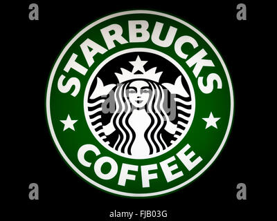 Starbucks Coffee sign with a black background - Stock Image