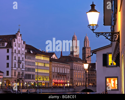 Switzerland, Zurich,Old Town Zurich and Limmat River front with Grossmunster Church at dusk - Stock Image