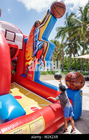 Miami Beach Florida North Beach Fire on the Fourth Festival July 4th annual event boy shooting basketball inflatable court hoop basket - Stock Image
