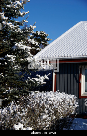 House with snow on the roof - Stock Image
