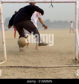 Nutmeged goalie - Stock Image