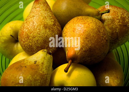 Pears and apples in a fruit bowl. - Stock Image