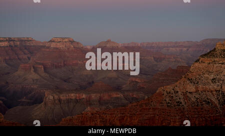 Dim sunset light at Grand Canyon, American national monument and park, view from the South Rim, Grand Canyon National Park, Arizona, USA - Stock Image
