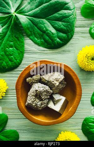 Pyrite with Shamrocks and Yellow Chrysanthemums - Stock Image