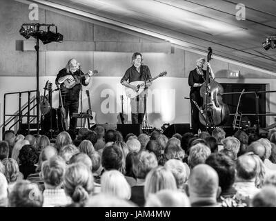 English acoustic roots folk trio 'Show of Hands' perform a concert at the Royal Horticultural Society in - Stock Image