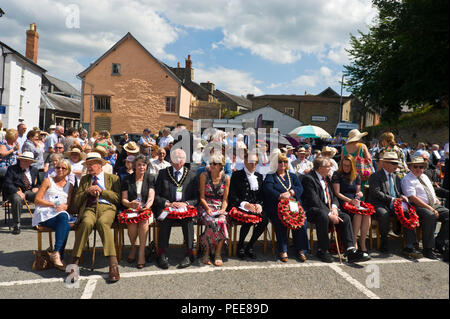 World War One commemorative event ceremony in the market square local dignitaries with poppy wreaths at Hay-on-Wye Powys Wales UK - Stock Image