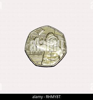 Limited edition British 50p piece coin commemorating the character Paddington Bear waving union jack flag - Stock Image