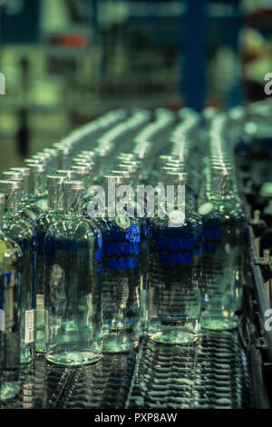 Absolut vodka made in Ahus,Skane region in south Sweden. Picture shows bottles on the assembly line - Stock Image