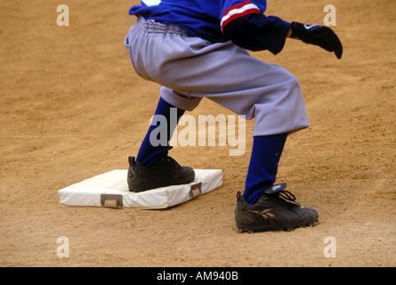 Boy on Base in Baseball Game - Stock Image