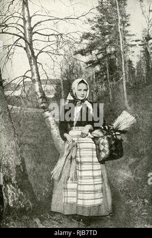 Young peasant woman in a wood, Finland. - Stock Image