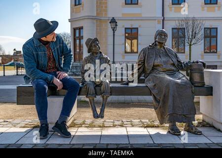 ALBA IULIA, ROMANIA - February 28, 2019: A young tourist man admiring the beautiful statues inside the Alba Carolina Citadel in Alba Iulia, Romania. - Stock Image