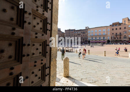 Piazza Del Campo, seen from the doorway to the Torre del Mangia, Siena, Italy Europe - Stock Image