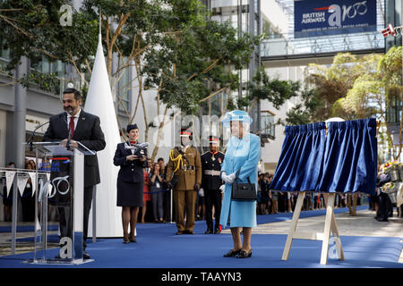 Queen Elizabeth II unveils a plaque to commemorate her visit to the headquarters of British Airways at Heathrow Airport, London, to mark their centenary year. - Stock Image