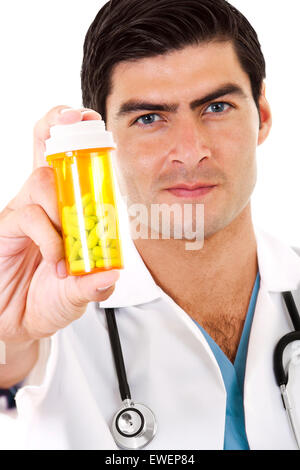 Stock image of doctor holding a bottle of prescription drugs - Stock Image