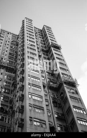 Weathered apartment block in Central, Hong Kong - Stock Image