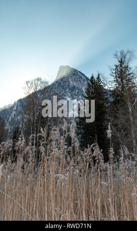 Sunlight illuminates the peak of the Kofel, the distinctive mountain in Oberammergau, Bavaria. - Stock Image
