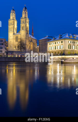 The Minster in Zurich illuminated at night - Stock Image