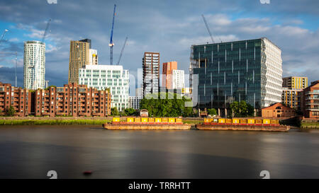 London, England, UK - May 28, 2019: Modern office and apartment buildings, including the US Embassy, stand among construction cranes in the Nine Elms - Stock Image