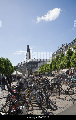 Copenhagen Denmark EU Bicycles parked in Hojbro Plads square with statue of warrier bishop Absalon founder of Copenhagen - Stock Image