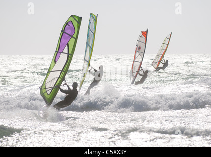 Windsurfing in formation off Guincho Beach near Lisbon, Portugal - Stock Image