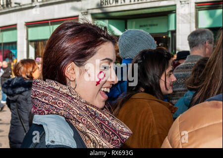 Cork, Ireland. 8th March, 2019. A young woman with a Venus symbol on her cheek attended a '#Walkout 4 Equality' protest on International Women's Day on Patrick Street, Cork. The women are protesting sexual violence, the 14% pay gap and the cervical check scandal, as well as other issues. Credit: Andy Gibson/Alamy Live News. - Stock Image