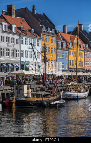 Copenhagen - Denmark.  Nyhavn or New Harbour  is a 17th century waterfront, canal and entertainment district from Kongens Nytorv to the harbour front. - Stock Image