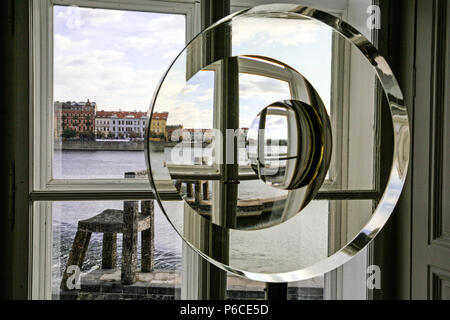 View across the Vltava through a circular window within an art gallery with the view repeating itself. Prague, Czech Republic. - Stock Image