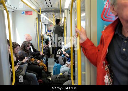 Passengers inside a railway carriage travelling on the Metro from Aeroporto Francisco sa Carneiro to the city centre of Porto Portugal EU KATHY DEWITT - Stock Image