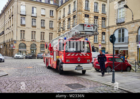 A large turntable fire engine in the narrow streets of Rennes the capital of Britanny, France - Stock Image