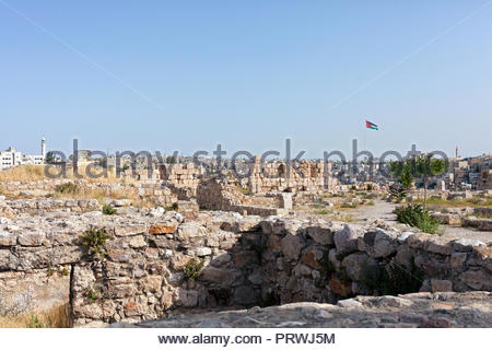 Greek Ruins in Amman with Modern City in the Background - Stock Image