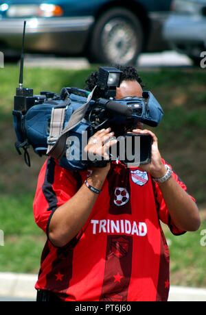 TV cameraman filming a news event - Stock Image