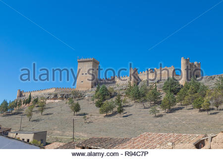 side view of old wall and turret of castle in Penaranda de Duero village, landmark and public monument from eleventh century, in Burgos, Castile and L - Stock Image