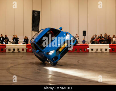 Stunt driver, Paul Swift drives his Ford Focus RS on two wheels, during his live precision driving  show, at London Motor Show 2018. - Stock Image