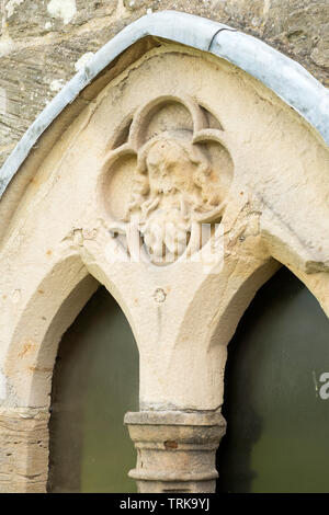 Carved stone face above a window in AydonHall, near Corbridge, Northumberland, England, UK - Stock Image