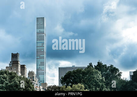 New York, September 24, 2018: 432 Park Avenue residential tower rises into cloudy sky, view from Central Park. - Stock Image