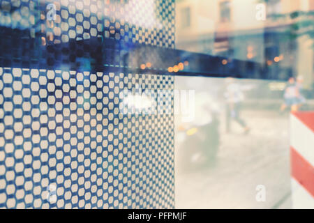 Reflection of the street in the shop window - Stock Image