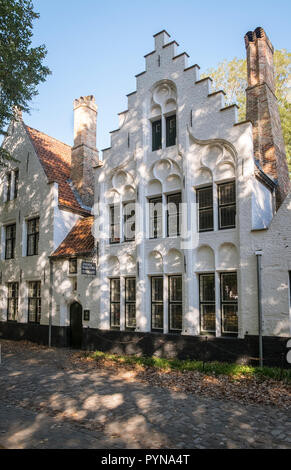 Example of step gabled religious accommodation found inside the Beguinage of Bruges, West Flanders, Belgium - Stock Image