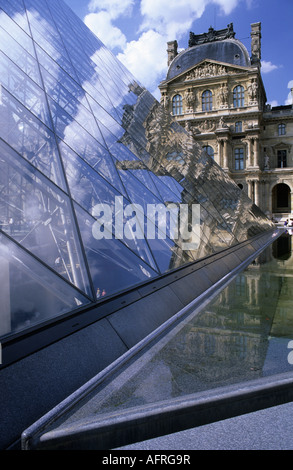Louvre reflections - contrasting architectural styles, contemporary glass pyramid reflecting the classical palace. - Stock Image